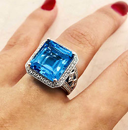 diamond and sapphire ring on woman's finger
