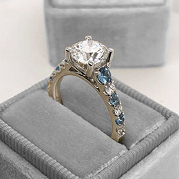 diamond and sapphire engagement ring in box