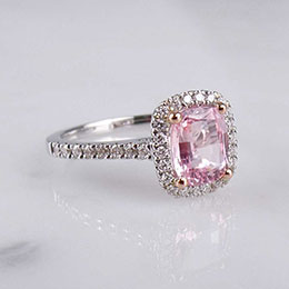 ring with diamonds and pink gemstone