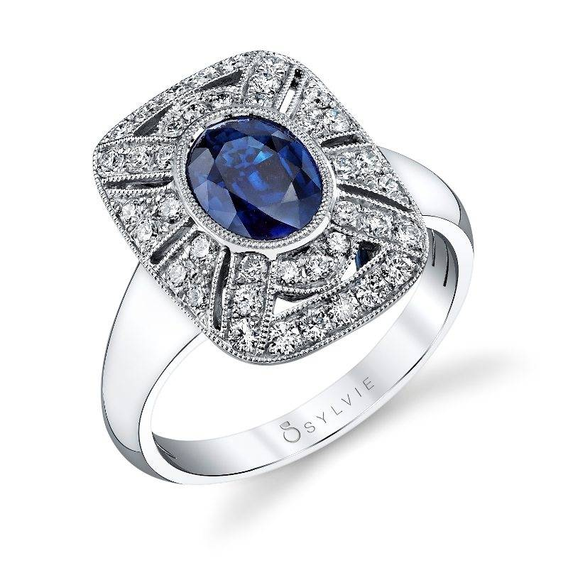 Vintage Inspired Oval Engagement Ring with Blue Sapphire