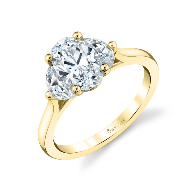 three stone engagement ring in yellow gold