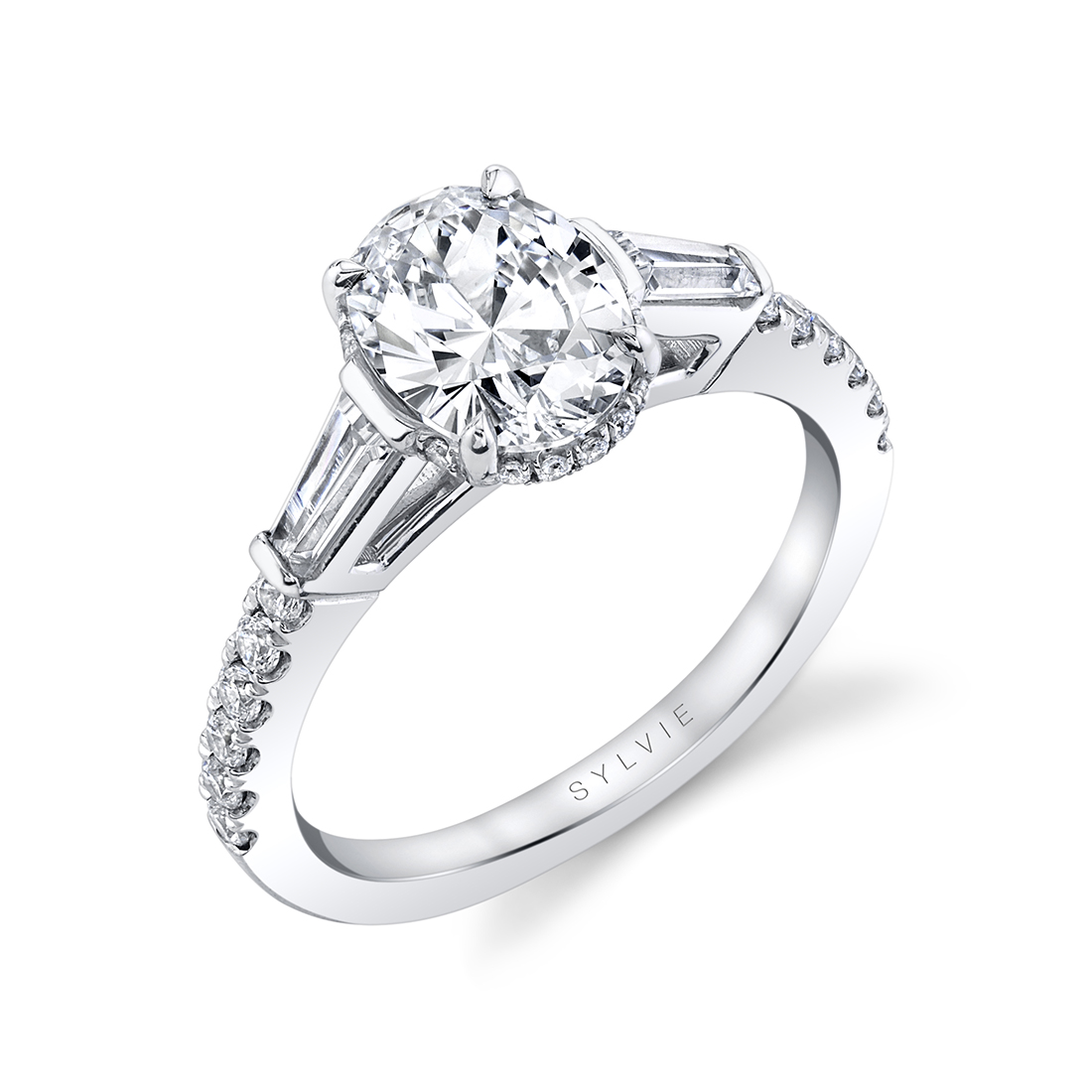 Oval engagement ring with baguette side stones  by Sylvie