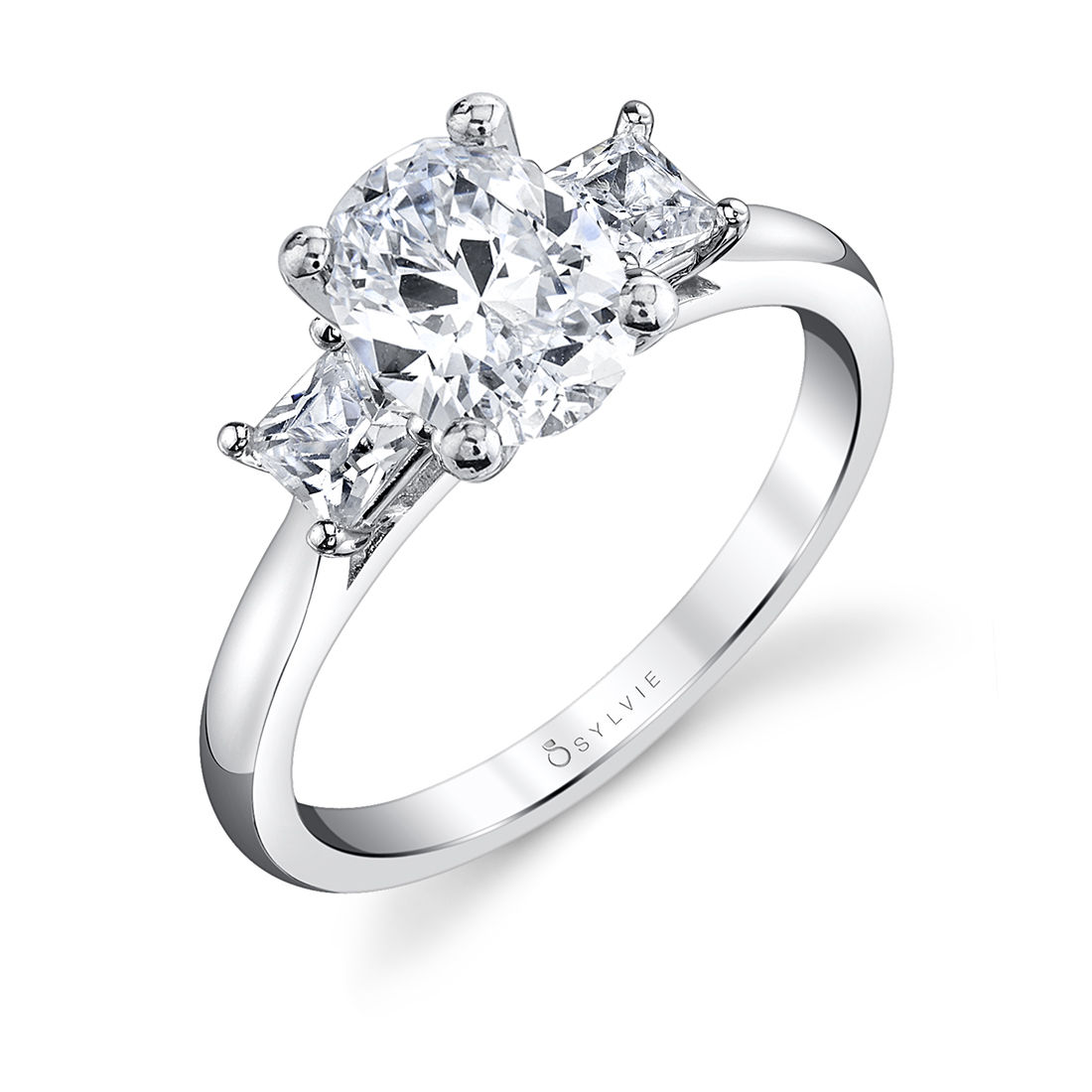 modern 3 stone oval engagement ring