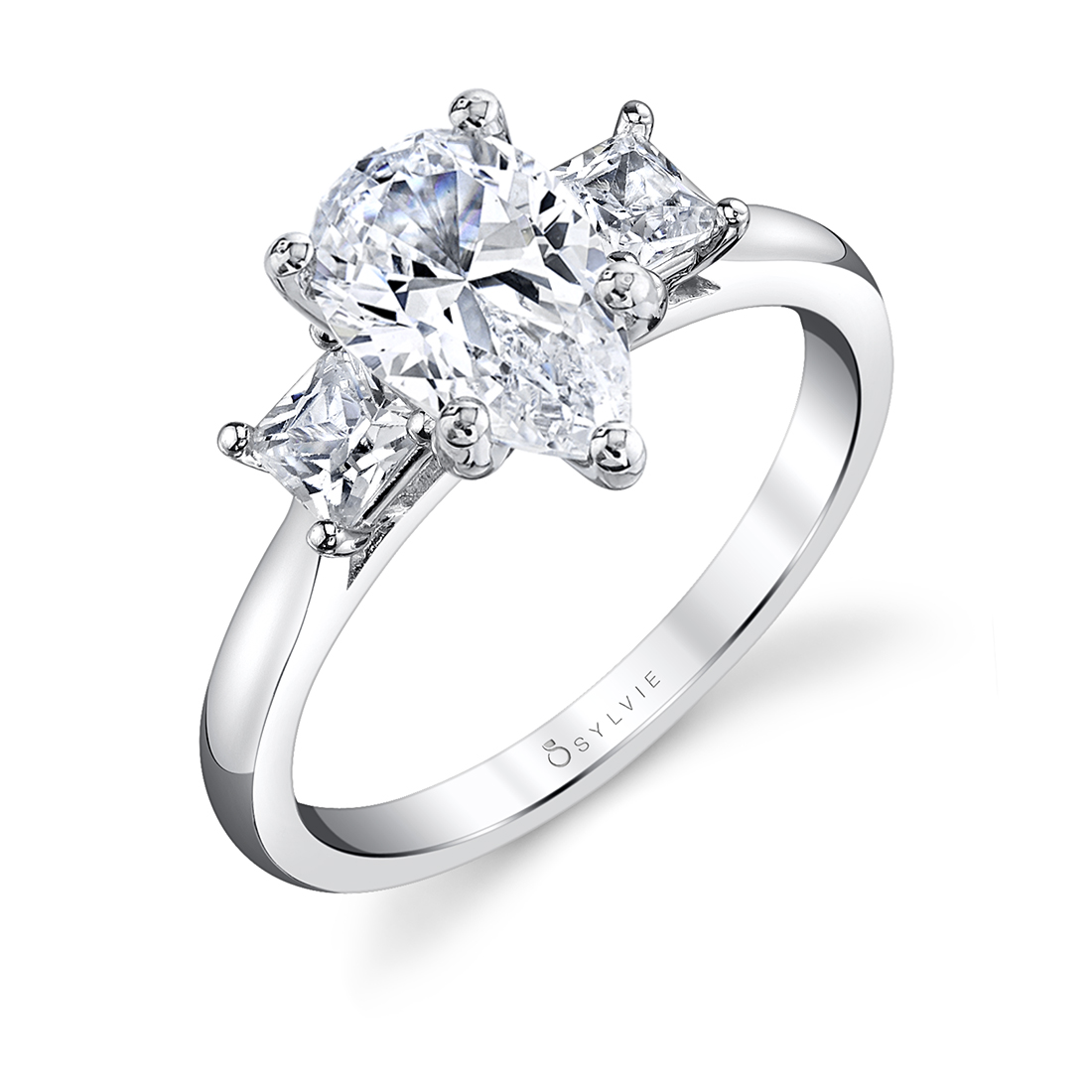 pear cut ring with princess cut side stones in white gold