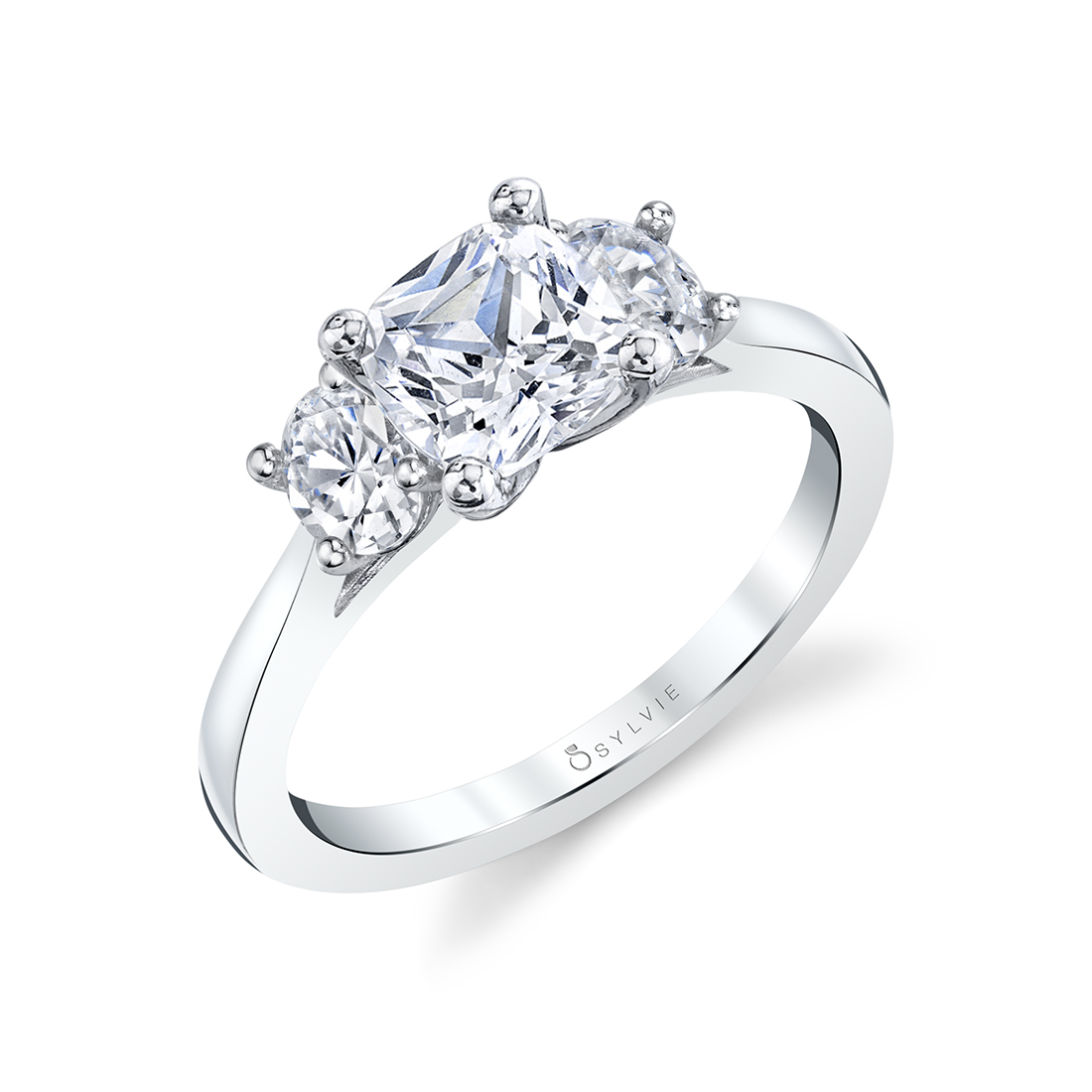 cushion cut 3 stone engagement ring in white gold