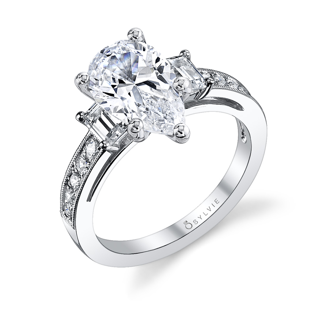 three stone pear shaped engagement ring in white gold