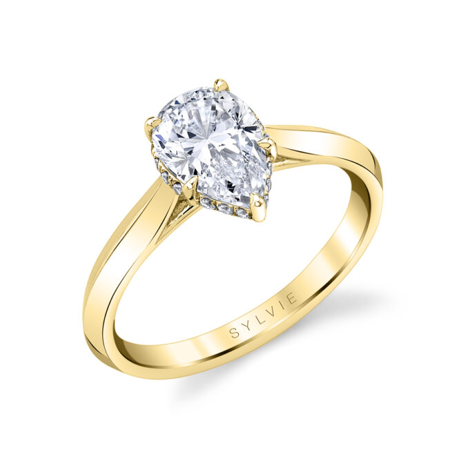 pear shaped hidden halo engagement ring in yellow gold