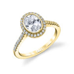 bezel set oval engagement ring in yellow gold