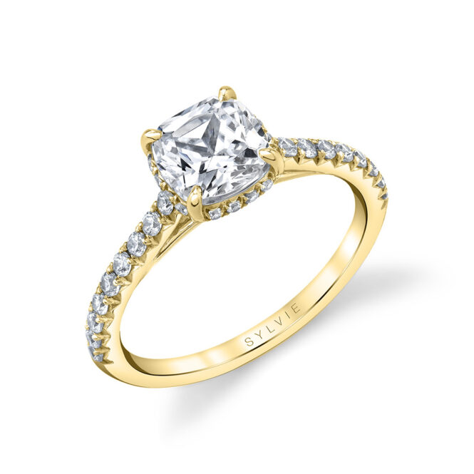 cushion cut hidden halo engagement ring in yellow gold