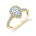 pear shaped halo engagement ring in yellow gold